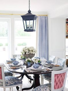 Fresh blue and white dining scheme - the hint of raspberry on the chair backs is witty and stylish - Ashley Whitaker