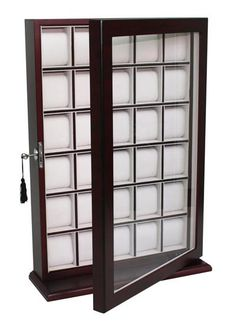 Tastefully protects, stores, and organizes up to 30 watches Hang on the wall or use as a stand with included base piece Eliminates clutter and keeps watches pro