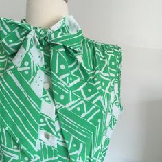 "Vintage 60s Abstract Dress *labeled ModCloth for exposure* This dress is so fun! It has a beautiful vibrant green design on a background of white. The perfect spring colors! It has a cute bow collar & iridescent buttons all the way down to the waist. It comes with a matching green belt. Genuine 60s vintage in immaculate condition! Comes from a smoke free home. Bust 38"", waist 28"". Vintage size 12, fits like a modern 8. ModCloth Dresses Midi"