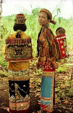 Indonesia | Bahau Busang women showing off their elaborate beaded baby carriers, East Kalimantan