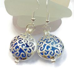 Please feel free to browse similar items in my Earrings category (link below):  http://etsy.me/1VRIKtz  DESCRIPTION:  A pair of 925 Sterling Silver Earrings with a round Silver Plated Filigree Locket each containing a Genuine Light Blue Sea Glass.  Handmade, drilled and assembled by me personally using Genuine Sea Glass (NOT TUMBLED) hand picked from the shores of the East Coast of England.  This item is a unique, one of a kind piece consisting of the following:  Genuine Light Blue Sea…