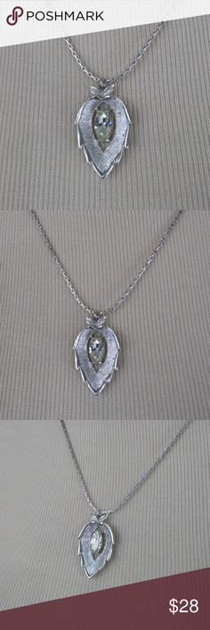 """VINTAGE Sarah Coventry Silver and Crystal Necklace This beautiful pendant by Sarah Coventry has a pretty frosted finish with a shiny silver border. In the center is a prong set Navette cut clear crystal. In good vintage condition, it measures 1 1/2"""" in length and the silver tone chain is 18"""" long. This is the original chain and there is no finish loss. The crystal is clear with no yellowing. Sarah Coventry Jewelry Necklaces"""