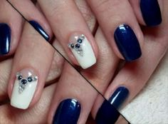 Elegant looking dark blue nail art design with white shades. The blue and the white color combination never fail to impress as they look perfectly good together on this design. Additional beads are added on top of the white polish to make it look even more interesting.