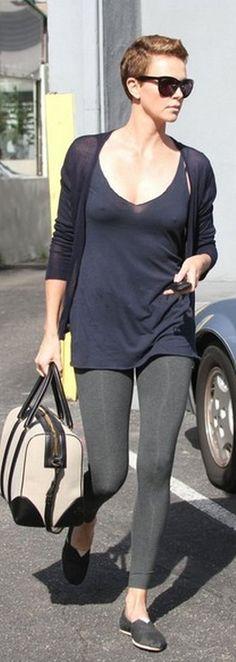 Who made  Charlize Theron's black shoes and two tone handbag?