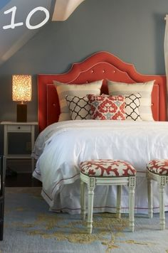coral colored tufted headboard with white piping