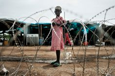 A girl stands inside the UN mission in South Sudan's military base in Tomping, near #Juba airport. The #UN has been criticised by aid organisations for an alleged failure to improve the sanitary situation in the area. Most refugees fear they will be killed if they leave the camp, either by government troops or civilians belonging to the Dinka tribe. Photographs by Jacob Zocherman