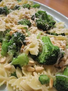 Ina Gartens Broccoli & Bowties Kosher salt 8 cups broccoli florets (4 heads) 1/2 pound farfalle (bow tie) pasta 2 tablespoons unsalted butter 2 tablespoons good olive oil 1 teaspoon minced garlic 1 lemon, zested 1/2 teaspoon freshly ground black pepper 1 tablespoon freshly squeezed lemon juice 1/4 cup toasted pignoli (pine) nuts Freshly grated Parmesan, optional