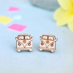 A playful pair of retro camper van stud earrings that VW fans will love! These camper van stud earrings are the perfect gift for those that love nothing more than frequent trips away in their beloved camper van, or for those that think the unique camper van design is just so darn cool! Whether you are celebrating your love of the iconic camper van design or cheering up a friend...these camper van earrings are the perfect way to bring sunshine and happiness into your life and to those around…