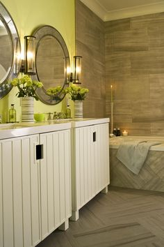 """A pair of Kohler's """"Chalkstripe"""" vanities are accented with a duo of luxe mirrors"""