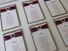 Burgundy and gold wedding table plan with diamante buckles. http://www.weddingparaphernalia.co.uk/diamante-buckle-wedding-table-plan.htm #wedding