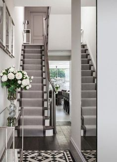 london carpet runner for with traditional artificial flowers staircase contemporary and framed wall art dark hardwood floor (wall art bedroom stairs) Flooring For Stairs, Hardwood Stairs, Wooden Stairs, Dark Hardwood, Painted Stairs, Wood Flooring, Flooring Types, Hardwood Floors, Stairs