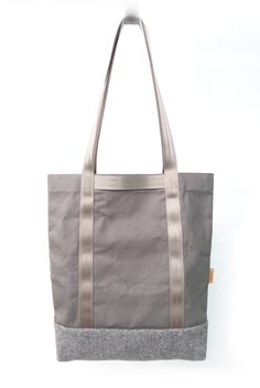 Utility Tote. The ultimate day-to-day carry solutions. Durable heavy-duty canvas material with nylon seatbelt webbing. Simply put your things in the proper place.