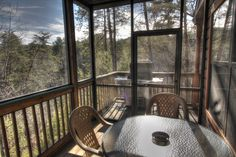 Sasquatch Ridge Pigeon Forge vacation rental cabin - enjoy a meal on the screen in deck area.