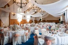 Wedding of Pumudi and Neil, February 2016 - white marquee canopy, gorgeous vintage pastel floral arrangements in mason jars wrapped with lace and hessian on timber rounds by With Love Florist, AUCKLAND, peach organza bows on white chair covers.