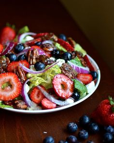 candied pecan berry salad with cream cheese and poppyseed dressing.