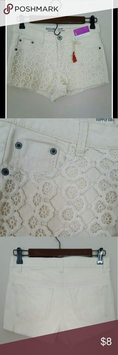 """Lacey Shorts Never worn cute off white high waisted denim cutoff shorts with lace front detail - 2 front slanted pockets and 2 usable square back pockets - front zipper and metal button closure - worn look on front pockets - 1 3/4"""" inseam so shorter shorts - 14"""" high waist - Size 5...these still have tags on them..never ever worn Mossimo Supply Co Shorts"""
