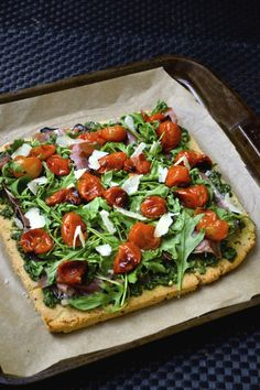 Herb Flatbread topped with pesto, grilled veggies and prosciutto. Grain Free, Paleo, SCD