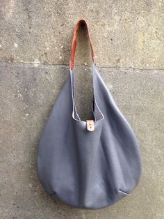 A great mothers day gift find it at https://www.etsy.com/listing/221175936/large-gray-grey-leather-hobo-shopper