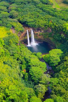 Wailua Falls is a waterfall located near Lihue (Kauai, Hawaii) that feeds into the Wailua River. The waterfall is prominently featured on the opening credits of the television show Fantasy Island. Kauai Hawaii, Mahalo Hawaii, Maui, Hawaii Travel, Hawaii Usa, Hawaii Honeymoon, Hawaii Beach, Honeymoon Ideas, Amazing Nature