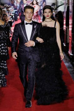 Cameron Dallas and Sonia Ben Ammar walk the runway at the Dolce & Gabbana secret show in Milan