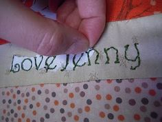 Sewing writing on fabric.
