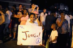 Ferguson Community Continues To Demonstrate Over Police Shooting Death Of Michael Brown