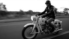 Black and White Photography of Vintage Biker and his Motorbike