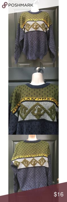 ✨ Vintage Oversized Unique Navy Sweater - Vintage Oversized Unique Navy Sweater  - Adorable navy blue sweater with army green design and color throughout top  - Main colors: navy blue, army green, and gray  - Cross designs at top  - Very unique one of a kind late 90s oversized sweater!  - Material: No tag but I'm guessing it is part wool and part cotton  - Size: L (Oversized style)  - Brand: Vintage  *20% off 2+ * Make me an offer!! Vintage Sweaters Crew & Scoop Necks