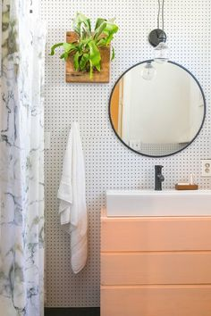 After: A Budget Rental Bathroom Makeover Under $500 | IKEA hacks and renters solutions completely renovated this small space apartment bathroom for less than $500. Check out the after -- including storage solutions and bathroom plants!