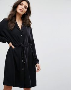 Buy it now. Y.A.S Loose Button Up Dress - Black. Dress by Y.A.S., Woven fabric, V-neck, Notch lapels, Button placket, Drawstring waist, Loose fit � falls loosely over the body, Machine wash, 100% Polyester, Our model wears a UK S/EU S/US XS and is 173cm/5'8 tall. ABOUT Y.A.S. Y.A.S. � �your apparel and style� � sees the successful Vero Moda Very transformed into a contemporary, fashion-forward brand. Exuding understated cool, Y.A.S. is for the independent girl who sees what she wear...