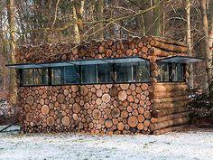 log home with cord wood
