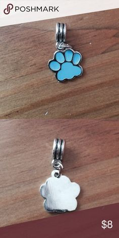 Dog Paw Charm Perfect for Any dog or animal lover. Charm fits all major charm bracelet brands. Can also be work as a pendant. Blue paw with silver detail. Please ask if you have questions. Jewelry