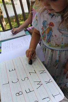 Quick and Easy Letter ID game: I quickly wrote several rows of letters on a wipe-off board and gave E the eraser.  She erased the letters as I called out the letter name or sound.  Chasing Cheerios: prereading activities