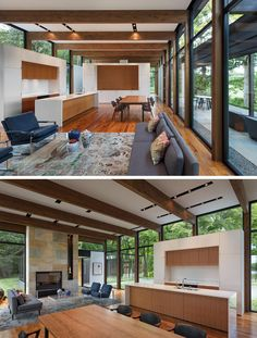This modern house has walnut flooring, exposed wood beams, white walls and a bluestone fireplace. #InteriorDesign #KitchenDesign #Fireplace