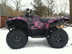 <3 This PINK Camo Four Wheeler!! I think I just found my Christmas or even birthday gift or bothe would be ok too!! :)