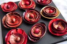 Polymer Clay Rosettes - picture tute.  Note shaping with light bulb.  #Polymer #Clay #Tutorials