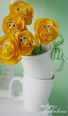 I would have a few different colored flowers and put them in a tall vase! super cute!