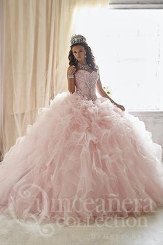 Hidden with flowing ruffles, you will find glittering additions of tulle. The outer skirt is fully removable, giving way to a short and fun tulle skirt. The bodice is remarkable for its large, shining