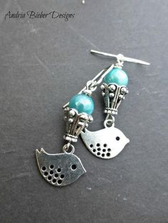 Bird silver charms and blue pearls.