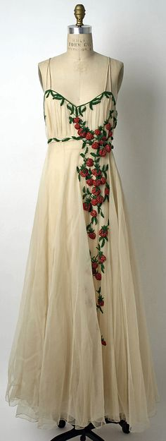 "Silk evening dress with glass bead berries and vines, by Mark Mooring for Bergdorf Goodman, American, 1942. Label: ""Bergdorf-Goodman in the Plaza, N.Y./Mrs. E. Garbisch, 6/11/42/No. 36352"""