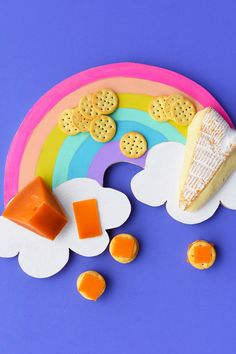 Grab some basic supplies at your local hardware store and make this fun and colorful rainbow cheese board for your next summer party!