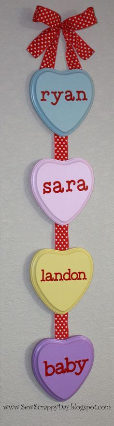 Easy Valentines Decoration: Painted wooden hearts + vinyl stickers + red ribbon -- from SewScrappyDay.blo...