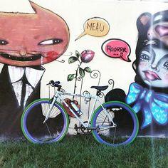 A Pure Fix Original Series bike with colored Kenda tires leans against an art wall. #bike #bicycle #fixie #fixedgear #art #streetart #graffiti