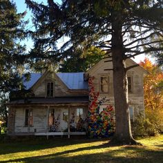 """Rosanne Martine-Braslow: Abandoned Everything Abandoned in WI... Abandoned farmhouse transformed into art. In """"Invasive Species"""" thousands of kudzu leaves, crocheted from plastic shopping bags, engulf an abandoned farmhouse. ~RB"""