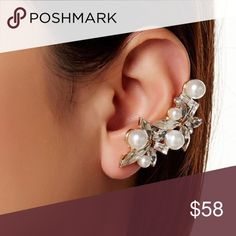 """BOHEMIAN EARRING Cluster Pearls Crawler Ear Cuff One Size. New with tags. $38 Retail + Tax.   - Beautiful cluster earring featuring stunning pearls and crystals along the ear lobe.  - Leads way to a trendy twist to classic stud earrings.  - Includes post & cuff back with matching pearl stud.  - Length: 1.75""""  Nickel & lead free. 18k plated metal, glass.  Imported.      {Southern Girl Fashion - Closet Policy}   ✔️ Same-Business-Day Shipping (10am CT). ✔️ Price shown is firm unless bundled. ❌…"""