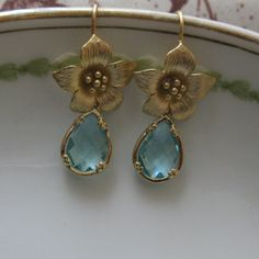 Gold Framed Aquamarine Glass Teardrop Pendants with narcissus flower earring posts.   by DesignsbyNoa, $30.00
