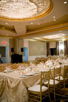 Vintage chic wedding with banquet tables in a ballroom