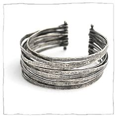 Modern, slightly industrial silver jewelry by Lisa Colby