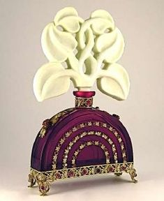 A beautful example of a Czech Ingrid bottle. It is a ruby jeweled glass bottle with ivory stopper.