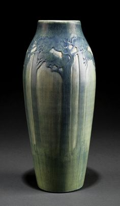 """A Monumental Newcomb College Art Pottery Matte Glaze Vase, 1913, decorated by Sadie Irvine with tall pines, blue and green underglaze, base marked with Newcomb cipher, decorator's mark, Joseph Meyer's potter's mark, reg. no. FU44 and """"B"""" for buff clay body, height 12 1/2 in. Provenance: The Charles and Susan Murphy Collection; Neal Auction Company, November 2, 2006, lot 200, illustrated page 39"""
